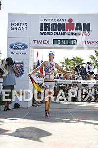 With country flag in hand,Michael Raelert celebrates his first place finish in the 2010 Foster Grant Ironman World Championship 70.3 in Clearwater,Fl.November 13, 2010.