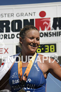 Jodie Swallow, adorned with her first place medal,smiles at the crowd in the 2010 Foster Grant Ironman World Championship 70.3 in Clearwater,Fl.November 13, 2010.