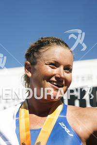 Jodie Swallow gives a victory smile to the crowd after winning the 2010 Foster Grant Ironman World Championship 70.3 in Clearwater,Fl.November 13, 2010.