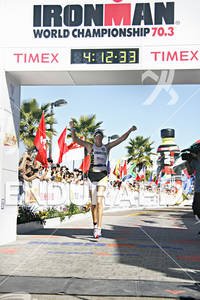 Leanda Cave raises her arms in celebration at the finish line after finishing second in the 2010 Foster Grant Ironman World Championship 70.3 in Clearwater,Fl.November 13, 2010.