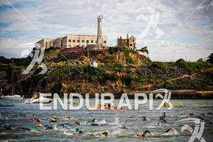 Athletes swim past Alcatraz at the 2011 Escape from Alcatraz.