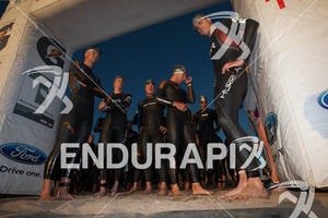 Pro men wait under starting arch to start the swim at the 2011 Ironman Boulder 70.3 triathlon on August 8, 2011 in Boulder, CO