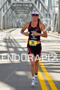 Donna Phelan (CAN) runs over 2nd Street Bridge at the 2011 Ford Ironman Louisville