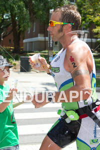 Chris McDonald (AUS) runs through aid station at the 2011 Ford Ironman Louisville