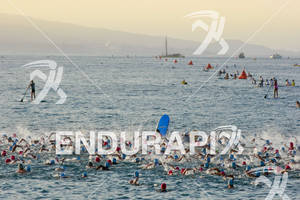 Age groupers begin to churn the water at the  start  of the swim portion of the 2011 Ford Ironman World Championship in Kailua-Kona, HI. October 8, 2011.