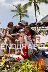 Craig Alexander is embraced by his family after crossing the finish line and winning  the 2011 Ford Ironman World Championship in Kailua-Kona,HI.