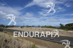Tom Lowe (GBR) rides during a solitary section up Hawi during the 2011 Ford Hawaii Ironman