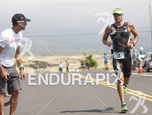 2010 Ironman World Champ Chris McCormack shouts encouragement to South African Raynard Tissink at the 2011 Ford Ironman World Championship