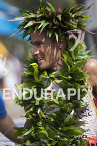 Craig Alexander celebrates his finish at the 2011 Ford Ironman World Championships