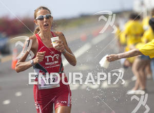 Chrissie Wellington takes on water during the marathon at the 2011 Ford Ironman World Championship