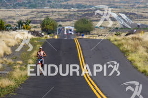 Craig Alexander (AUS) runs down into Energy Lab at the 2011 Ford Ironman World Championship