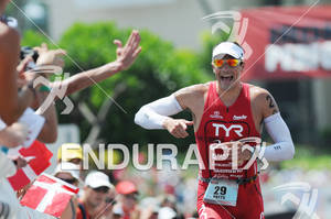 Andy Potts reacts at Hot Corner running up Palani Road after T2 at the run portion of the 2011 Ford Ironman World Championship in Kailua-Kona. HI, October 8 2011