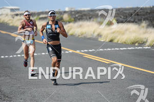 Mike Agrioz passes Faris Al-Sultan in the run portion of the 2011 Ford Ironman World Championship in Kailua-Kona. HI