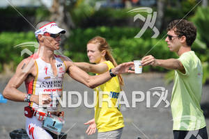Craig Alexander taking a cup of water at an aid station in the run portion of the 2011 Ford Ironman World Championship in Kailua-Kona. HI