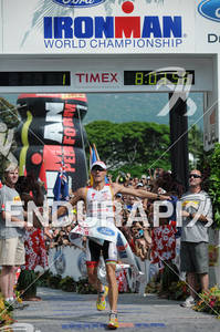 Craig Alexander crosses the finish line celebrating his third win and a new course record at the 2011 Ford Ironman World Championship in Kailua-Kona,HI. October 8, 2011.