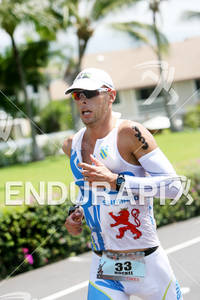 Dirk Bockel competing in the run portion of the 2011 Ford Ironman World Championship in Kailua-Kona, HI. October 8, 2011.