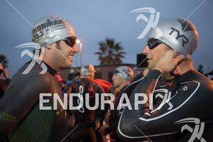 Matt Lieto and Jessie Thomas share a laugh before the swim start  at the  Ironman 70.3 California on March 31, 2012  in Oceanside, CA