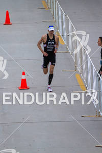 Andy Potts gets shouts of encouragement from a spectator on the run at the  Ironman 70.3 California on March 31, 2012  in Oceanside, CA