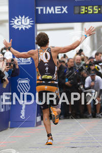Jesse Thomas celebrates down the finish shoot at the  Ironman 70.3 California on March 31, 2012  in Oceanside, CA