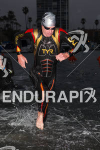 Richie Cunningham exits water in the new freak suit at the  Ironman 70.3 California on March 31, 2012  in Oceanside, CA
