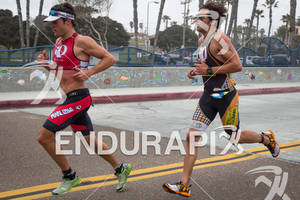 Leon GRIFFIN with Jessie Thomas on his heals at the  Ironman 70.3 California on March 31, 2012  in Oceanside, CA