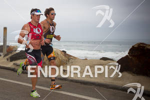 Jessie Thomas and Leon GRIFFIN run side by side on the Strand at the  Ironman 70.3 California on March 31, 2012  in Oceanside, CA