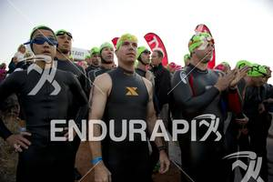 Age-groupers wait to enter the water for the swim start at Ironman St. George in St. George, Utah May 5, 2012.