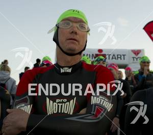 An age-grouper waits calmly before entering the water  for the swim start at Ironman St. George in St. George, Utah May 5, 2012.