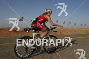 Meredith Kessler reaches for water at an aid station while competing in the bike portion of the Ironman St. George in St. George, Utah May 5, 2012.