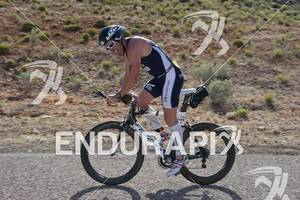 Heath  Thurston reacts as he battles head winds while competing in the bike portion of the Ironman St. George in St. George, Utah May 5, 2012.