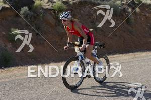 Meredith Kessler out of the saddle climbing while competing in the bike portion of the Ironman St. George in St. George, Utah May 5, 2012.