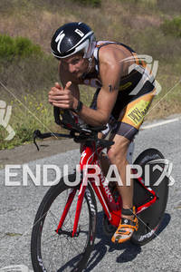 Winner Jesse Thomas gives the thumbs up as he holds his position on the bike patiently waiting for the run where his skilsl shine at the 30th Anniverary WIldflower Triathlon - May 5, 2012