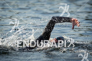 Andy Potts finishes the swim in 45 minutes at the Ironman Lake Placid Triathlon on July 22, 2012 at Lake Placid, NY