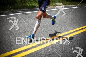 Andy Potts runs in first place at the 2012 Ironman Lake Placid Triathlon in Lake Placid, NY on July 22, 2012