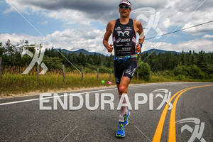 Andy Potts on second lap of the run at the 2012 Ironman Lake Placid Triathlon in Lake Placid, NY on July 22, 2012