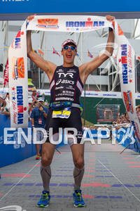 Andy Potts is victorous at the 2012 Ironman Lake Placid Triathlon in Lake Placid, NY on July 22, 2012
