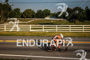 MICHELLE GAILEY on bike as the sun rises over the Kentucky horse farms at the 2012 Ironman Louisville on August 26, 2012 in Louisville, Kentucky