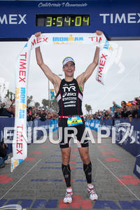 Andy Potts is victorious at the finish at the of the Ironman 70.3 California on March 31, 2012  in Oceanside, CA
