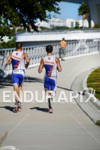 Blind athlete Aaron Scheidies,right, in tandem on the run course…