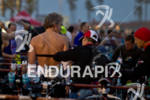 Age group athlete gets assistance in T1 before the swim…