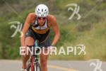 Rachel Challis out of the saddle at the Rohto Ironman…