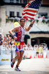Tim O'Donnell runs the finish with American Flag at the…