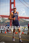 Andy Potts runs past the Golden Gate Bridge at the…