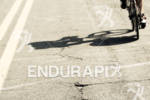 Shadow of an athlete on bike at the Ironman 70.3…
