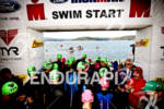 Age group athletes fill the beach at the start of…