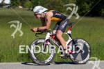 Adam Jensen on bike at the 2011 Ford Ironman Coeur…