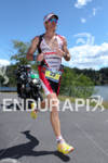 Craig Alexander on run at the 2011 Ford Ironman Coeur…