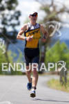 Adam Jensen on run at the 2011 Ford Ironman Coeur…