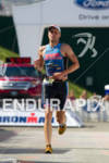 Tim Snow finishes at the 2011 Ford Ironman Lake Placid