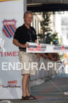 Mayor Greg Fischer hold finisher tape at the 2011 Ford…